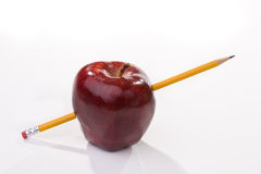 Ripe red apple. With pencil stock photo