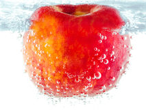 Ripe red apple with bubbles underwater Stock Photo
