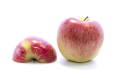 Ripe red apple half sliced invert with raw ingredient Stock Images
