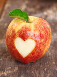 Ripe red apple with heart shape Royalty Free Stock Images