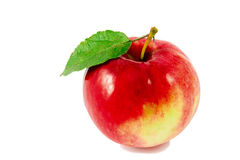 Ripe red apple with leaf isolated on white Stock Photography
