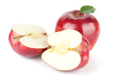 A Ripe Red Apple With Leaf and two halves Royalty Free Stock Images