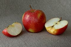 Red apple on linen cloth. Ripe red apple on linen fabric royalty free stock photos