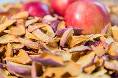 Ripe red Apple lying in a pile of dried fruit Royalty Free Stock Images