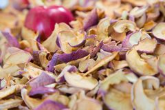 Ripe red Apple lying in a pile of dried fruit Royalty Free Stock Photos