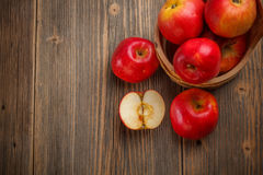 Ripe red apple. On old wooden board Stock Photos