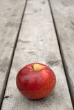 Ripe red apple on old wooden table Royalty Free Stock Photography
