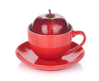 Ripe red apple in tea cup Royalty Free Stock Photography