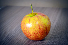 Ripe Red Apple  on Wood background. Royalty Free Stock Photography