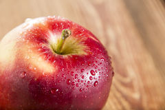 Ripe red apple. On wooden table Stock Photos