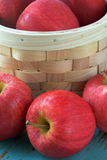 Ripe red apples with basket Stock Photography