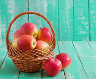 Ripe red apples in a basket Royalty Free Stock Photo