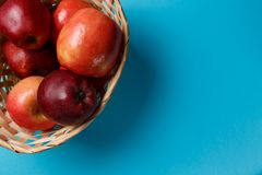 Ripe red apples in a basket royalty free stock photos