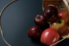 Ripe red apples in a basket. On a dark background. Top view royalty free stock images