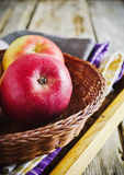 Ripe red apples in a basket Royalty Free Stock Photography