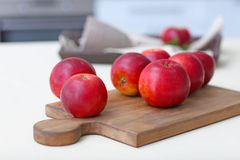 Ripe red apples on board. Ripe red apples on wooden board royalty free stock images