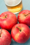 Ripe red apples with a glass of cider Royalty Free Stock Image