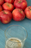Ripe red apples with a glass of cider Royalty Free Stock Photo