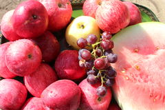 Ripe red apples and grapes Stock Images