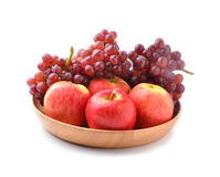 Ripe red apples and grapes on white Royalty Free Stock Photo