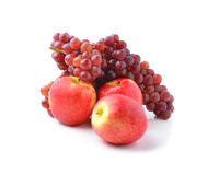 Ripe red apples and grapes on white Stock Image