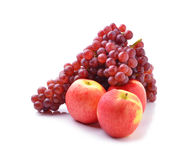 Ripe red apples and grapes on white Royalty Free Stock Photos