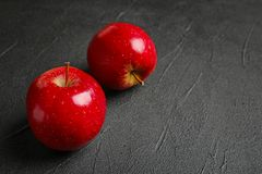 Ripe red apples. On grey background royalty free stock image