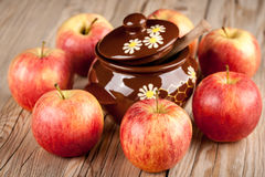 Ripe red apples and honey pot on wooden table Royalty Free Stock Photography