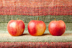 Ripe red apples on linen tablecloth Royalty Free Stock Photo