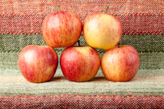 Ripe red apples on linen tablecloth Stock Image
