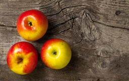 Ripe red apples on an old wooden gray background Royalty Free Stock Images