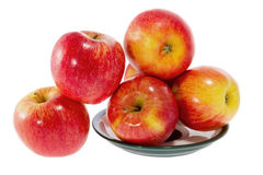Ripe red apples on a plate Stock Photo