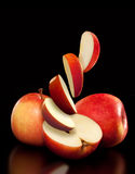 Ripe red apples and slices Stock Image