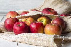 Ripe red apples on the table and cloth Royalty Free Stock Photo