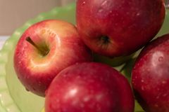 Ripe red apples with water drops closeup as background stock images