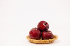 Ripe red apples in wicker basket isolated on white background Royalty Free Stock Image