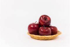 Ripe red apples in wicker basket isolated on white background Stock Image
