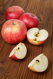 Ripe red apples on wood table Stock Image