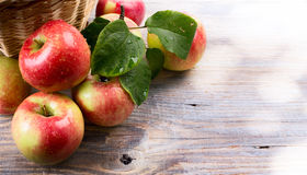 Ripe red apples on wooden background Royalty Free Stock Photography