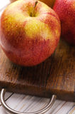 Ripe red apples on wooden background Royalty Free Stock Images