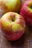 Ripe red apples on wooden background Stock Photography