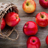Ripe red apples on wooden background. Ripe red apples on table close up stock photo