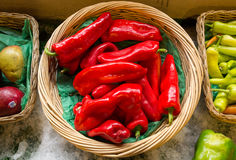 Ripe Red Bell Pepper in Basket on Ice Stock Photo