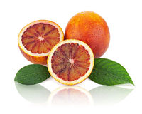 Ripe red blood oranges with cut and green leaves  on whi Royalty Free Stock Photos