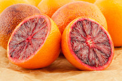 Ripe red blood oranges and slices Royalty Free Stock Photos