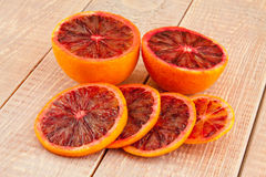 Ripe red blood oranges and slices Stock Photos