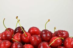 Ripe red cherries. Drops of water on cherries. White background Stock Images