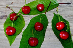 Ripe red cherries with green leaves Stock Photo