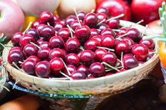 Ripe red cherry in basket. Royalty Free Stock Images