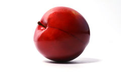 Ripe red cherry pink plum on a white background Royalty Free Stock Image